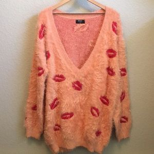 Fuzzy pink sweater with lip detail